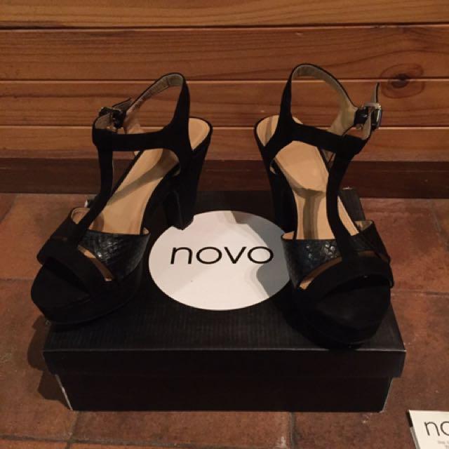 Size 7 Novo black strap platforms worn once