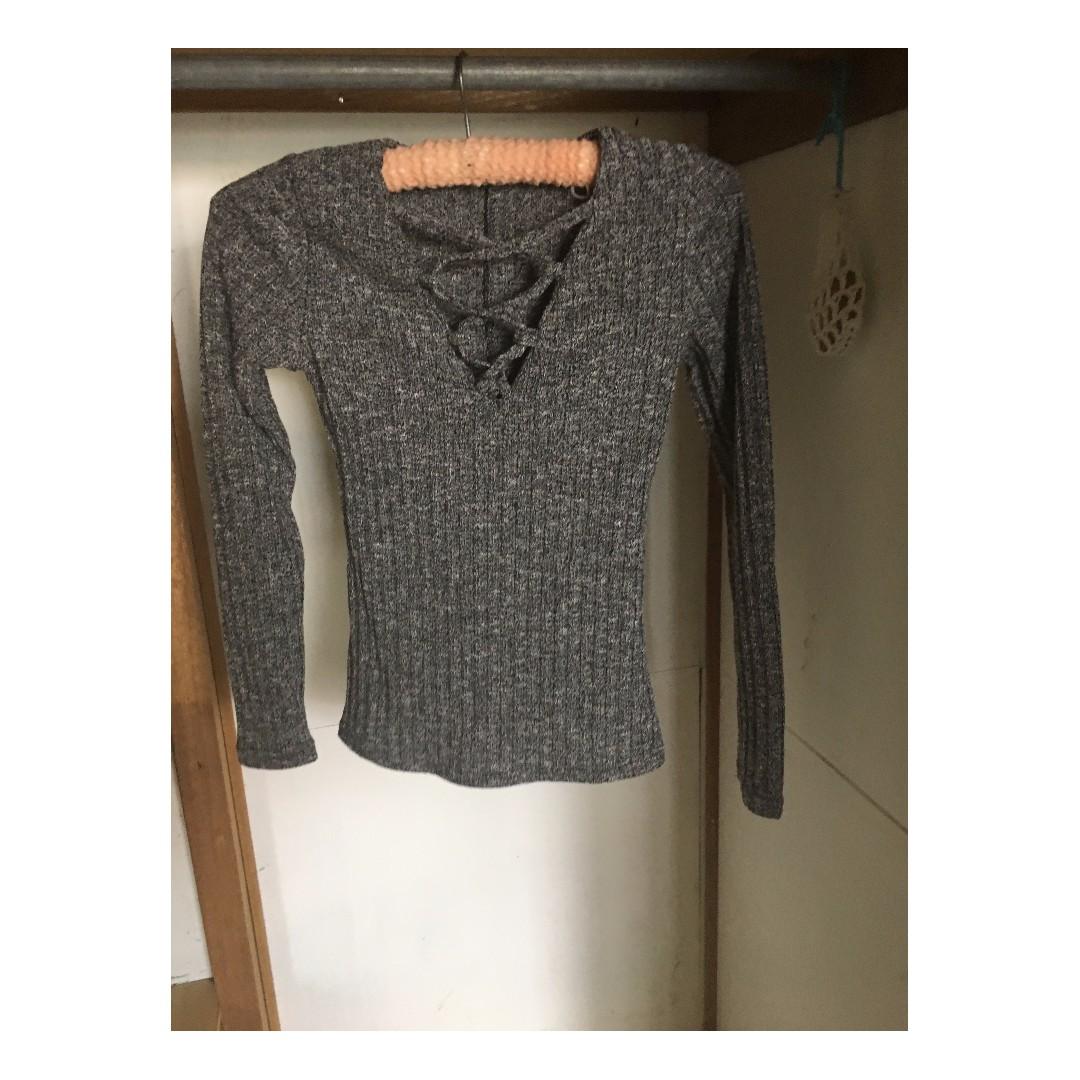 Small tight grey knit long sleeve top