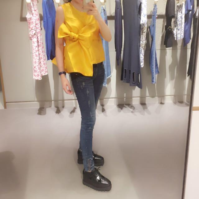 Top ribbon kuning