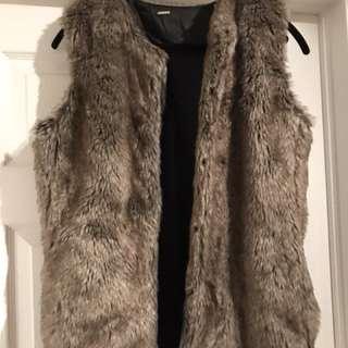 Brand new with tags aldo fur vest, has pockets.