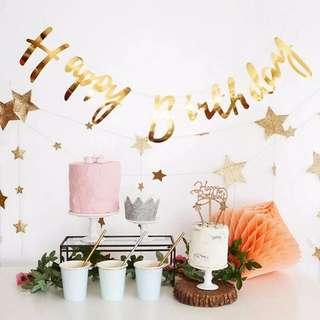 Golden happy birthday banner & golden star decorate