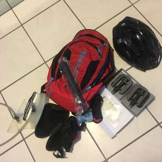 Cycling bag with its water bag + helmet + pedals + small bag to attach in the bike + pump