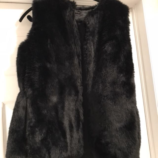 Brand new with tags aldo fur vest, has pockets