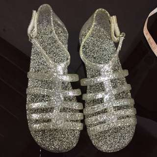 Place glittering sandals