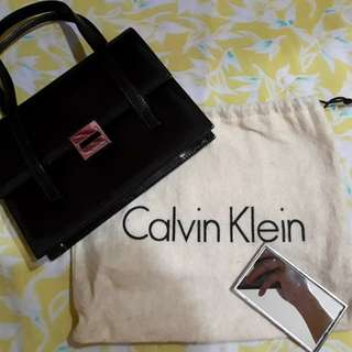 Preownwd Authentic Calvin Klein bag with mirror