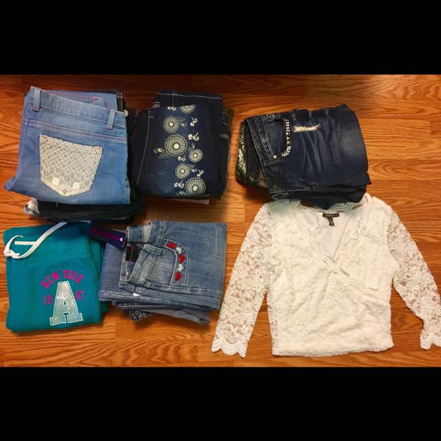 20 pairs of jeans, one pair of sweats and one lace cute top