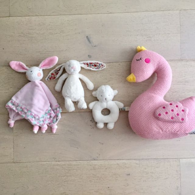 Assorted baby soft toys and rattles