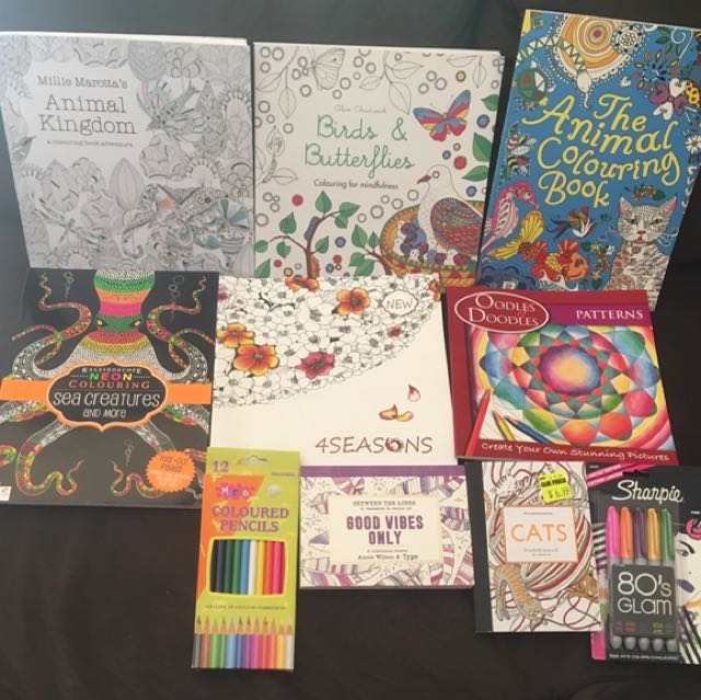 Colouring books plus sharpies and pencils