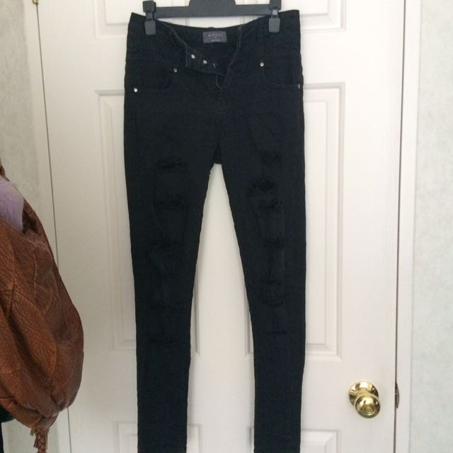 High waisted distressed ripped black jeans