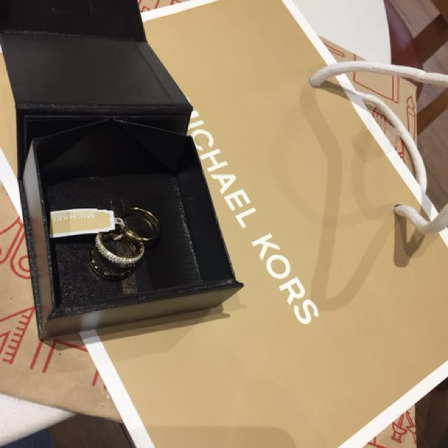 Michael korrs ring (gold platted) bought at michael korrs edsa shangrila 💯 original rfs Too big for me  size 7 😉 complete with box and paper bag