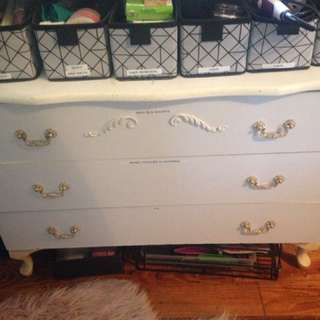 White dresser and side table.