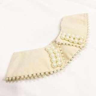 Pearl white wear on Peter Pan collar