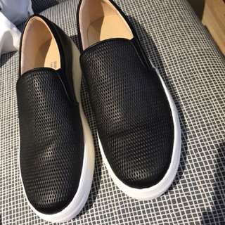 Dr. Kong's black leather slip-on sneakers