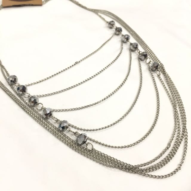 Long drop necklace with metal balls