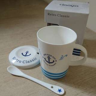Blue anchor mug with cover and stirrer