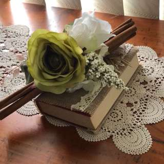 Cinnamon stick with artificial flowers