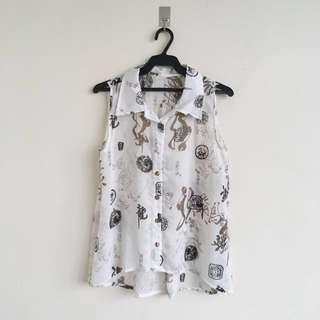 Sleeveless white button down blouse