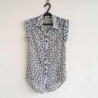Sleeveless animal print button down blouse