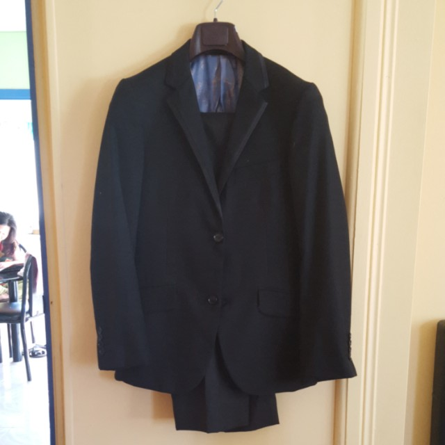 Black suit include blazer and pants