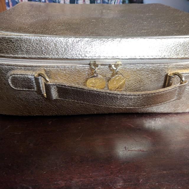 Estee Lauder gold makeup jewelry bag