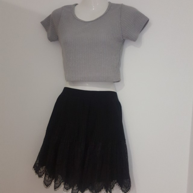 Grey crop top with black skirt