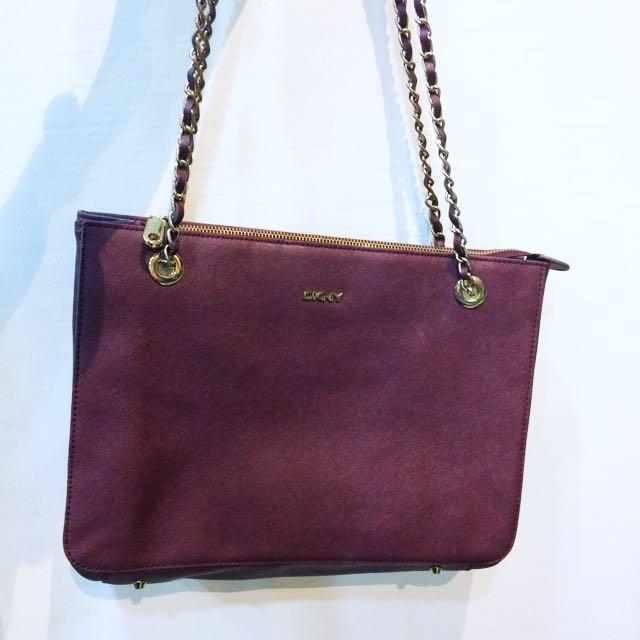 Original  DKNY sling bag in maroon