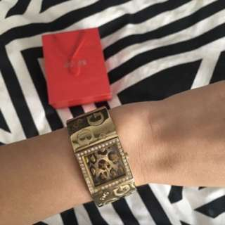Guess watch. Gold colour with leopard print