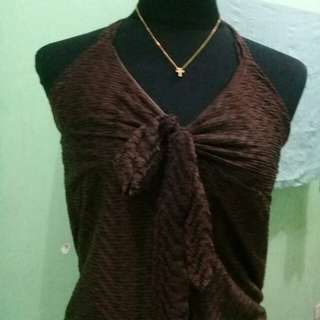 Backless brown blouse with detailed design