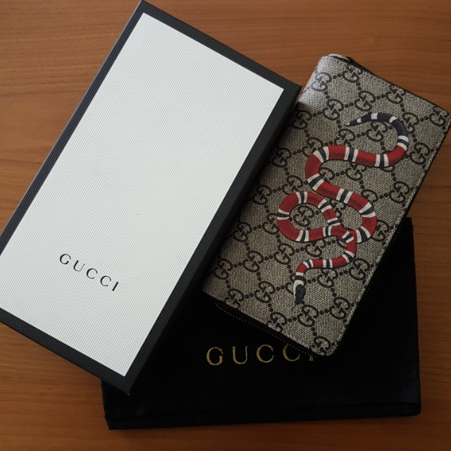 34a358b7cf7 Gucci Kingsnake print GG Supreme zip around wallet
