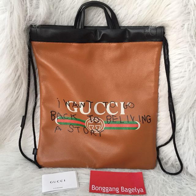 925929a6436d Gucci Print Leather Drawstring Backpack, Men's Fashion, Bags ...