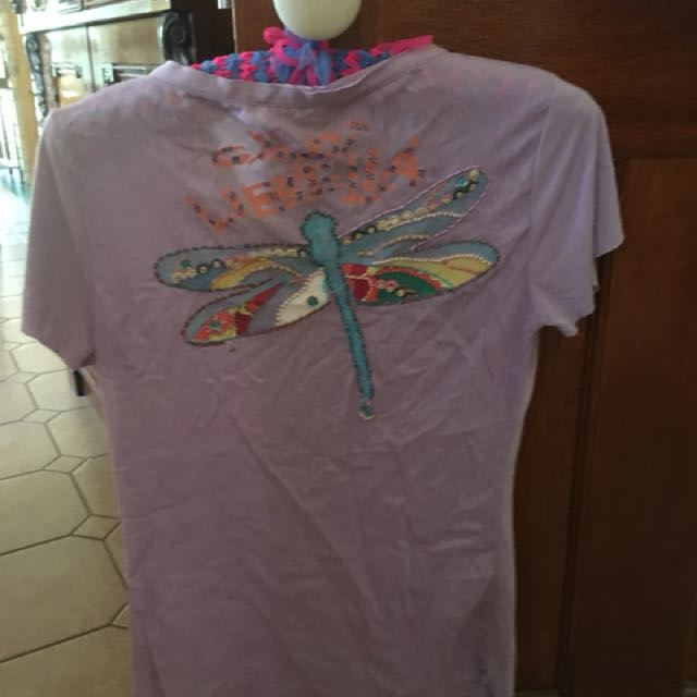 New purple shirt with butterfly on back small