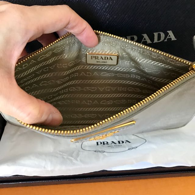 6a9b5dd2933f Prada leather pouch brand new, Luxury, Bags & Wallets on Carousell