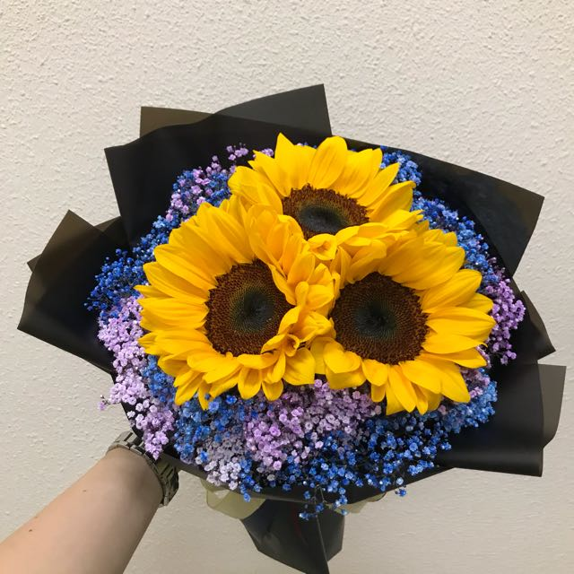 Sunflowers with purple and blue baby breath bouquet
