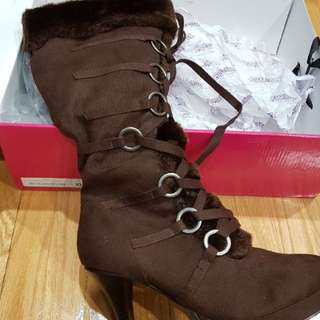 Brand new in box $50 or best offer winter heels size 10 but fits a 9