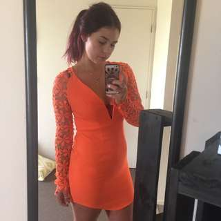 Beautiful orange dress.