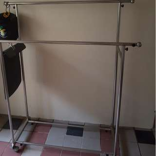 Pre-loved custom made solid stainless steel cloth hanger