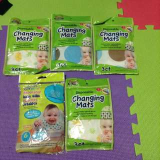 Disposable baby bibs and changing mats