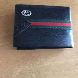 Gucci and LV wallet