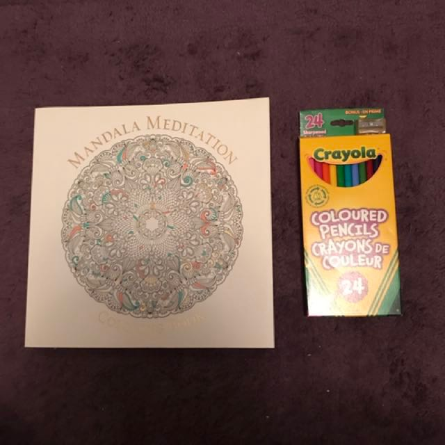 Adult colouring book and pencil crayons