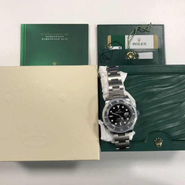 BNIB Rolex Submariner Date. Ref: 116610LN. Brand New; with box, with papers, and stickers intact.