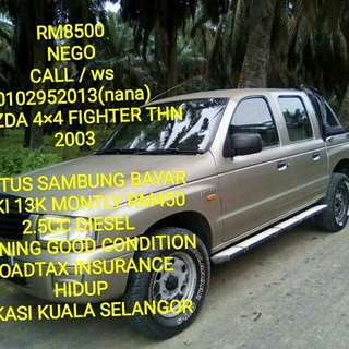 Mazda 4x4 fighter thn 2003