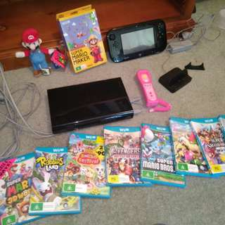 Wii U and games and everything else in the photo