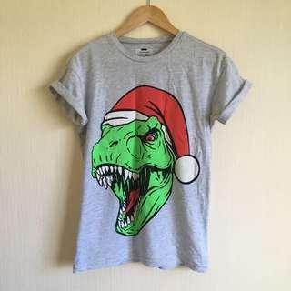 Christmas tee ft. T-Rex wearing a Santa hat