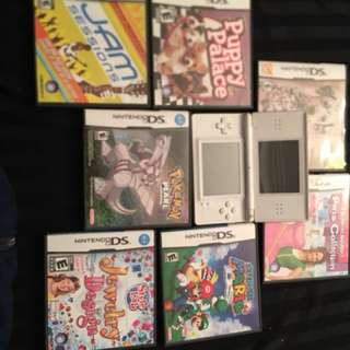 White nintendo ds with game cases
