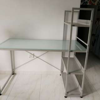 Pre owned study table with tempered glass top.