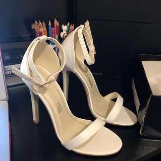 Pretty little things white strap heels