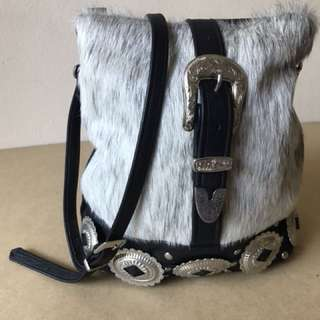 LAIR leather bag with cow hide detail