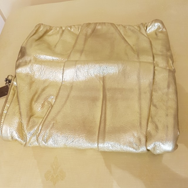 Authentic Dolce & Gabbana Clutch In Gold