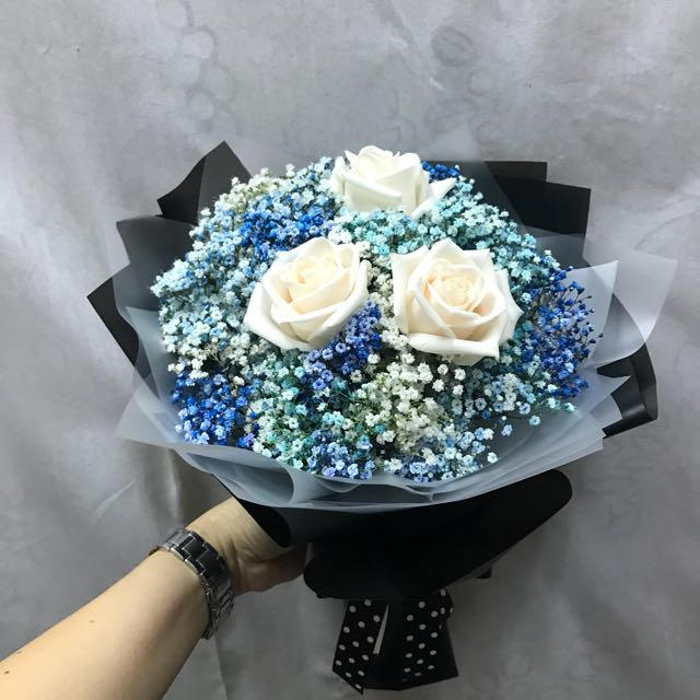 Cream roses with blue and white Baby Breath Hand Bouquet