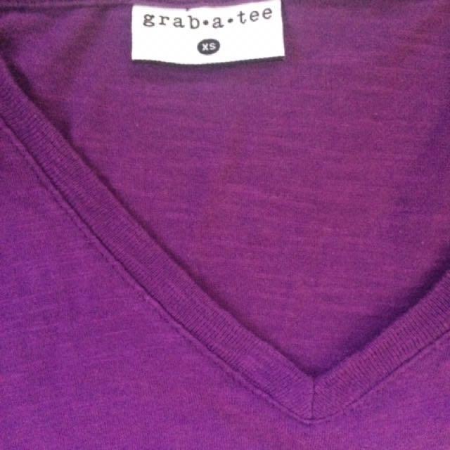 Purple V-neck shirt